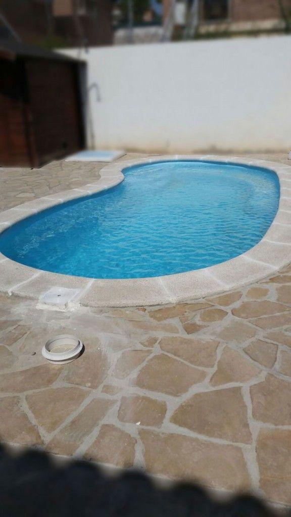 Terraza piedra alcover en piscina reformas reus for Piscina alcover